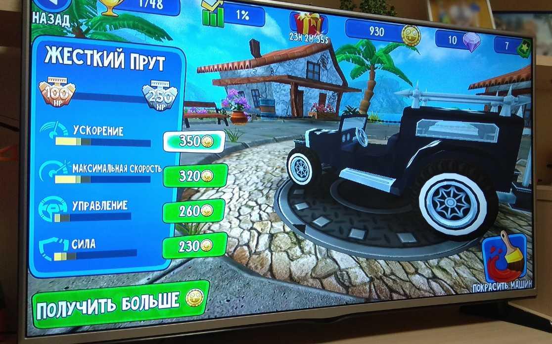 Android TV-приставка с запущенной игрой